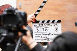 man holding clapper board